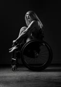 Nude-woman-in-wheelchair-posing-in-studio
