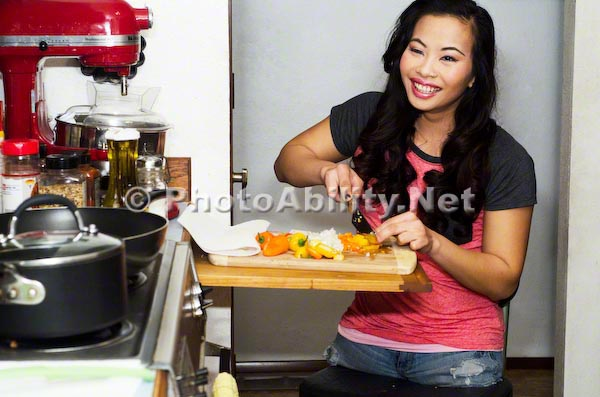 Young amputee woman preparing a meal