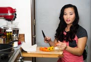 Young-amputee-woman-preparing-meal
