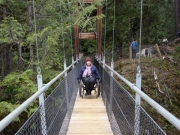 Woman-in-wheelchair-on-suspension-bridge-on-the-Oregon-Coast-Trail