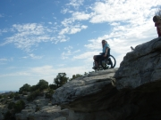 Woman-in-wheelchair-exploring-rock-formation