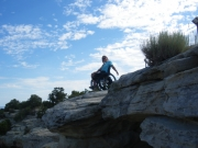 Woman-in-wheelchair-on-top-of-rock-formation