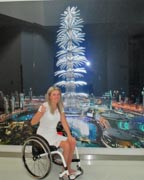 Young-woman-traveler-using-wheelchair-visiting-Dubai