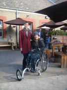 Mother-in-wheelchair-with-her-daughter-at-an-outdoor-restuarant