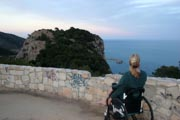 Woman-tourist-in-wheelchair-at-an-ocean-viewing-lookout