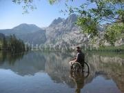 Man-in-wheelchair-fishing-in-mountain-lake