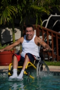 Man-jumping-into-his-pool-in-his-wheelchair