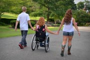 Mother-in-wheelchair-enjoying-summer-afternoon-with-her-teenage-children