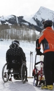 Woman-in-wheelchair-getting-into-sit-ski