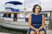 Young-woman-in-wheelchair-on-marina-dock