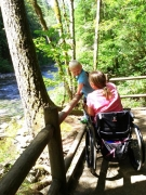 wheelchair;disability;disabled;mobility;river;lookout;trail;forest;woods;accessible;accessibility;sunny;woman;female;child;family