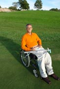Man-in-wheelchair-playing-golf