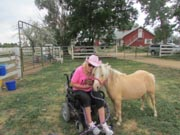 Woman-in-wheelchair-with-her-pony