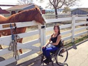 Young-woman-in-wheelchair-with-her-horse