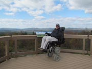 Man-in-power-wheelchair-on-an-observation-deck-in-national-park