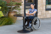 A-young-woman-using-wheelchair-conversing-on-cell-phone