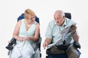 Disabled-couple-chatting-to-one-another-over-newspaper,
