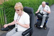 Disabled-couple-out-in-the-street-using-mobile-phones-to-communicate-with-one-another,