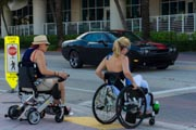 Two-women-in-wheelchairs-enjoying-an-afternoon-in-seaside-town