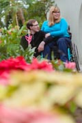 Young-mother-in-wheelchair-with-her-family-at-botanical-garden