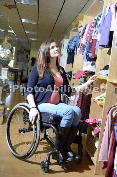 4aae84fec961e Pregnant Mom in wheelchair shopping for new baby