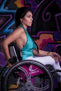 Young-woman-in-wheelchair-admiring-street-art