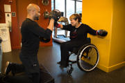 Woman-using-wheelchair-at-the-gym