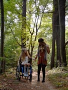 Young-girl-in-wheelchair-in-the-forest