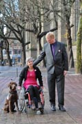 Couple-on-city-sidewalk-with-their-service-dog