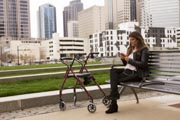 Young-woman-with-mobility-aid-exploring-the-city