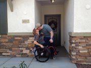 Couple-kissing-on-the-threshold-of-new-home
