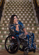 Young-woman-in-wheelchair-in-front-of-staircase
