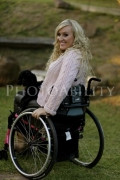 Young-woman-in-wheelchair-enjoying-the-garden