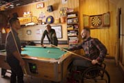 Man-in-wheelchair-playing-pool
