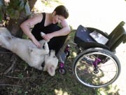 Young-in-wheelchair-in-the-garden-with-her-dog