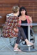 Woman-in-wheelchair-in-cafe-with-her-friend