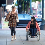 Young-woman-in-wheelchair-shopping-with-her-friend