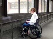 Female-doctor-in-wheelchair-at-the-end-of-her-shift