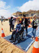 Official-opening-of-the-Mt-Martha-lifesaving-club-accessible-beach.-Mt-Martha-is-the-first-beach-on-Melbournes-Mornington-Peninsula-to-offer-accessible-beach-facilities-for-people-with-disability-including-full-accessible-change-facilities-and-now-beach-matting-to-the-waters-edge.-The-matting-has-been-made-possible-by-the-Mornington-Peninsula-Shire,-Mt-Martha-Lifesaving-Club-and-the-Mornington-Peninsula-Disabled-Surfers-Association.