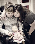 Girl-in-wheelchair-with-her-friend-playing-with-doll