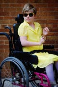 Portrait-of-girl-in-wheelchair-on-patio