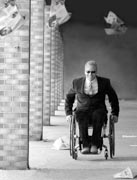 Businessman-in-suit-using-wheelchair