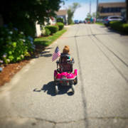 Young-girl-exploring-in-her-pink-power-wheelchair