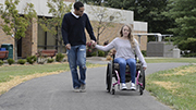 Young-woman-in-wheelchair-out-for-stroll-with-her-boyfriend.